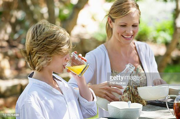 Mother having food with her son outdoors
