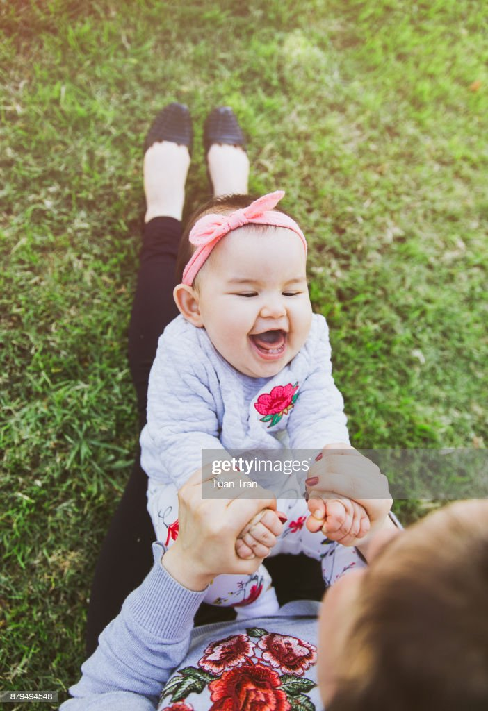 Mother having fun with daughter : Stock Photo
