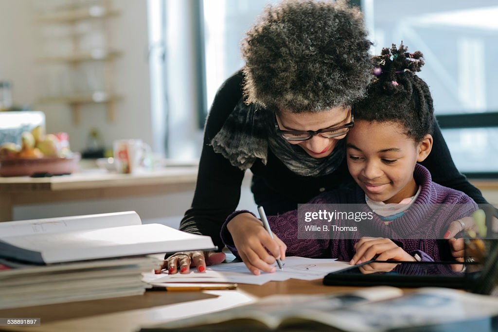 Mother helping Daughter : Stock Photo