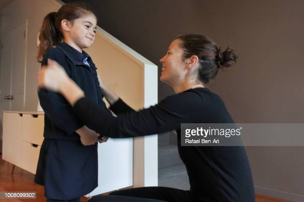 Mother Helping Daughter to Get Ready for School