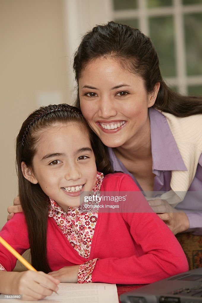 Mother helping daughter with homework : Stockfoto