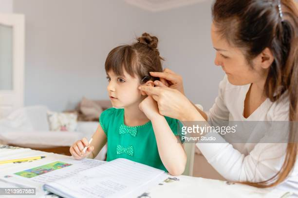 mother helping daughters with homework - alertness stock pictures, royalty-free photos & images