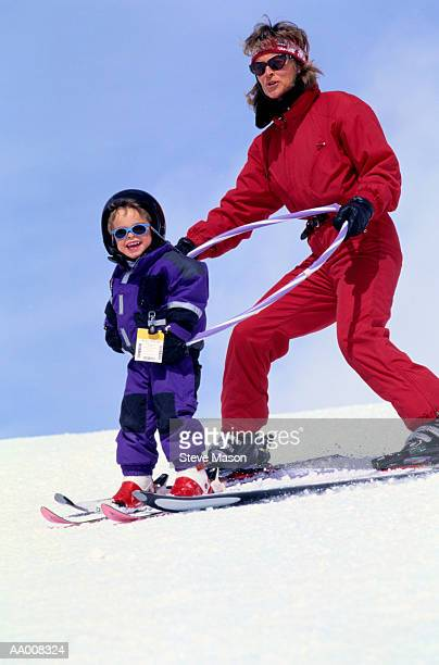 Mother Helping Her Daughter Learn to Ski