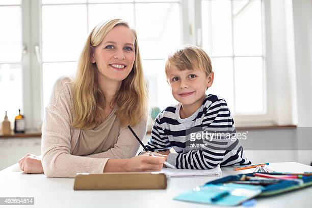 Mother helping her son with his homework