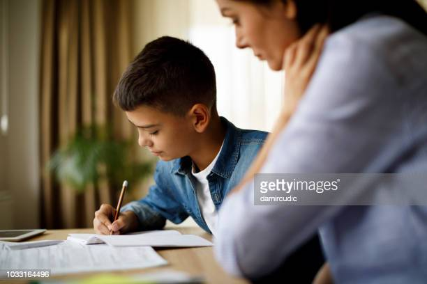 mother helping her son with homework - homework stock pictures, royalty-free photos & images