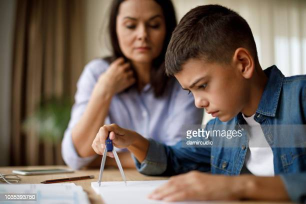 mother helping her son with homework - drawing compass stock pictures, royalty-free photos & images