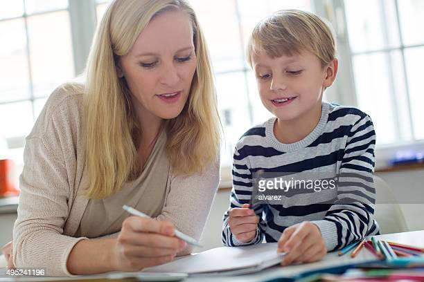 Mother helping her son with homework