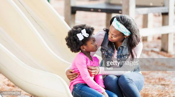 mother helping sad little girl on playground - penalty stock pictures, royalty-free photos & images
