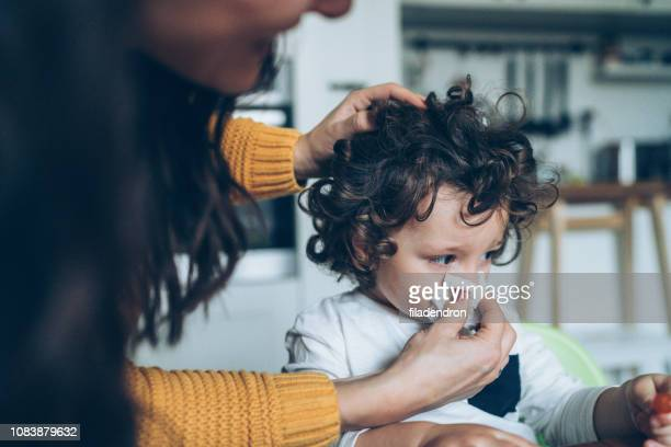 mother helping son to blow his nose - pneumonia stock pictures, royalty-free photos & images