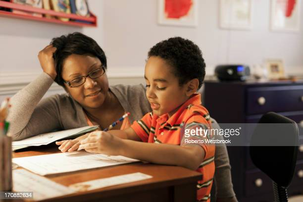 Mother helping son with homework