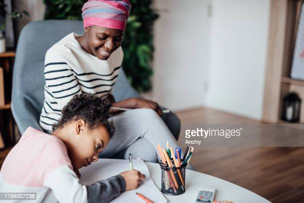 Mother Helps Daughter With Homework