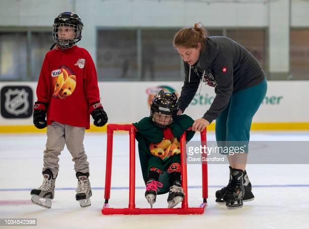 A mother helps her child learn to skate as the participate in the free skate during Kraft Hockeyville Canada on September 16 2018 at the Lucan...
