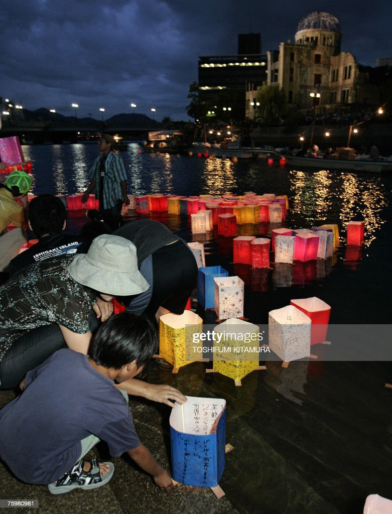 A mother helps her son to send off floating lanterns on the Motoyasu river, beside the Atomic Bomb Dome (R), 06 August 2007 to mourn victims of the atomic bombing of Hiroshima in 1945. Japan vowed never to seek atomic weapons and urged nuclear powers to give up their own arsenals 62 years after the world's first nuclear attack on Hiroshima. Some 45,000 people recited silent prayers at 8:15 am, the exact moment in 1945 when a single US bomb instantly killed more than 140,000 people and fatally injured tens of thousands of others with radiation or horrific burns.