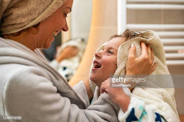 mother helps son to dry hair - drying stock pictures, royalty-free photos & images