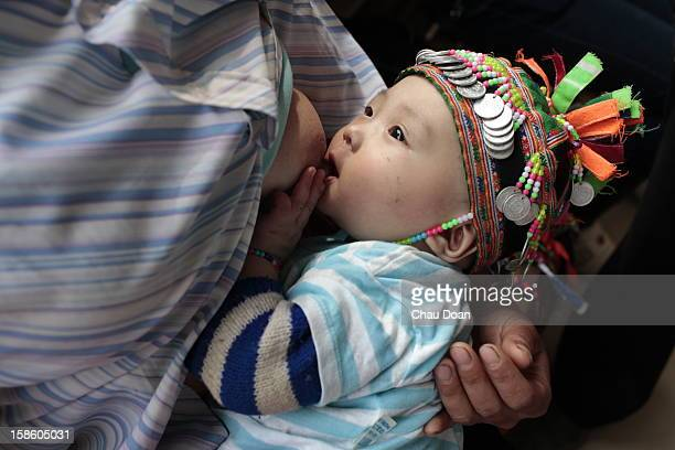 A mother her baby in Bao Lam district hospital The World Health Report 2005 Ð Make Every Mother and Child Count says that in that year almost 11...
