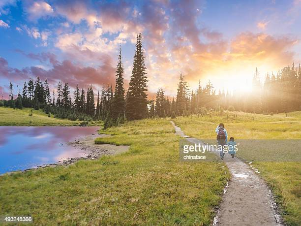 mother hiking with daughter at mt.rainier - washington state stock pictures, royalty-free photos & images