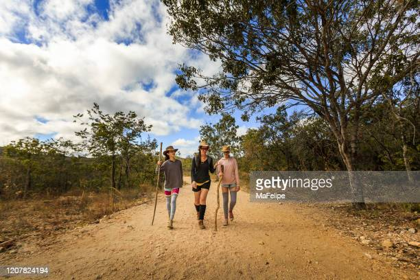 mother hiking with her daughters in a trail in chapada dos veadeiros national park, goias, brazil - goias stock pictures, royalty-free photos & images