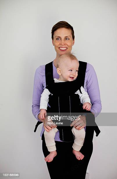 Mother holding a baby boy in a carrier