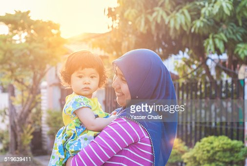 Mother Holding A Baby Girl