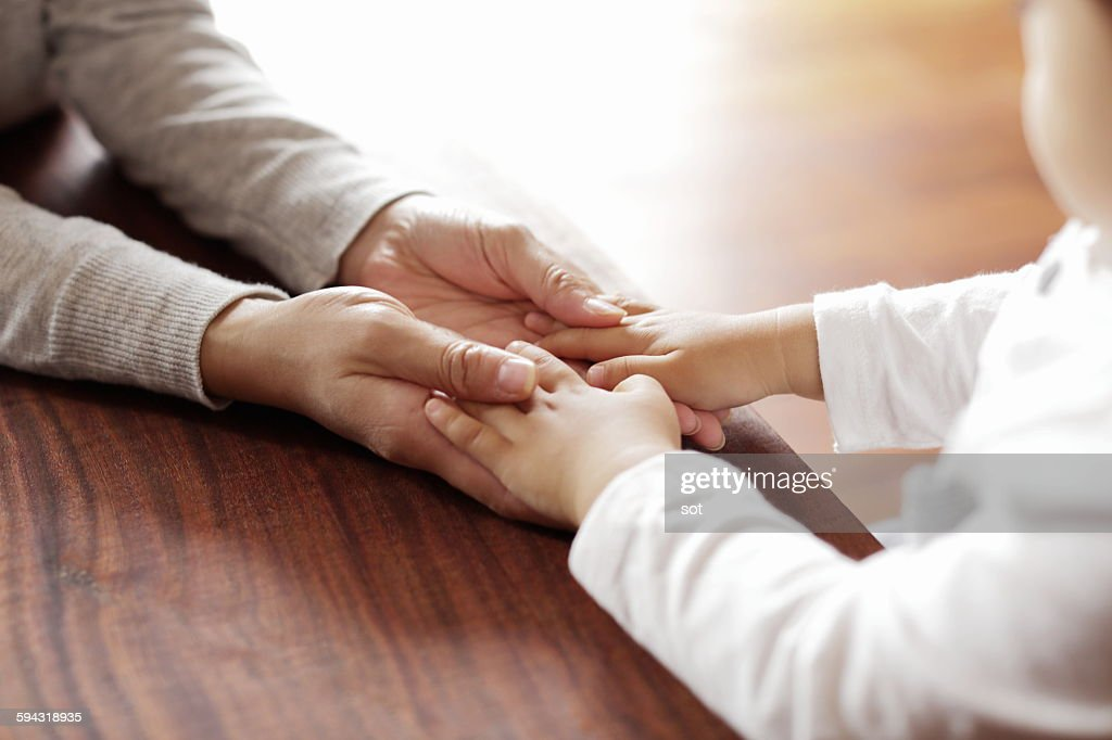 Mother holding baby boy hand,close up : Stock Photo