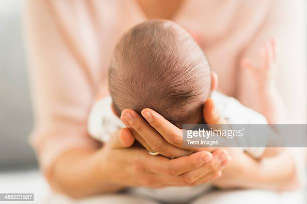 mother holding baby boy (2-5 months) - mexican and white baby stock photos and pictures