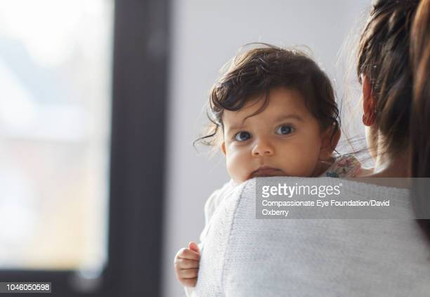 Mother holding baby girl