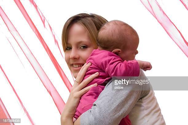 mother holding baby on shoulder