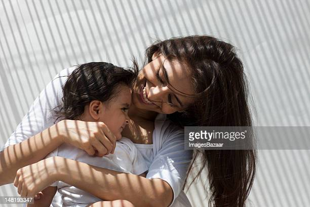 Mother holding baby son (12-17 months)