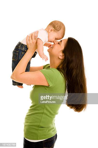 Mother holding daughter in air tapping her nose