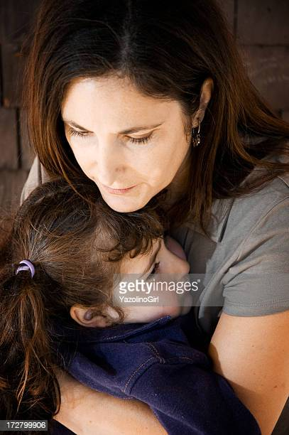 Mother holding daughter (series)