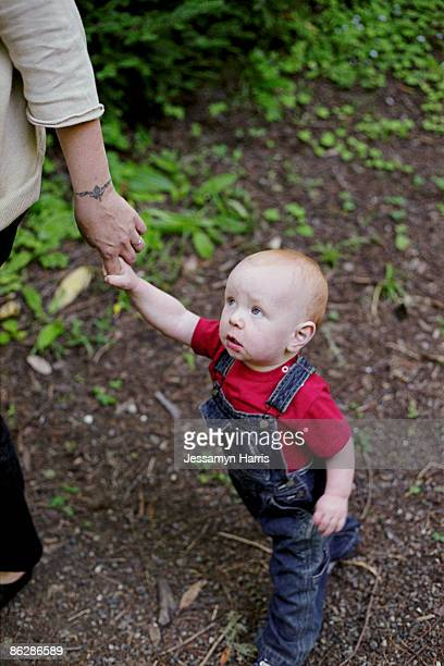 Mother holding hand of a baby boy