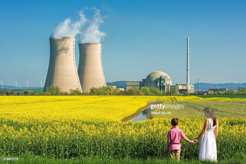 Mother Holding Hands with Son at Nuclear Power Station : Stock Photo