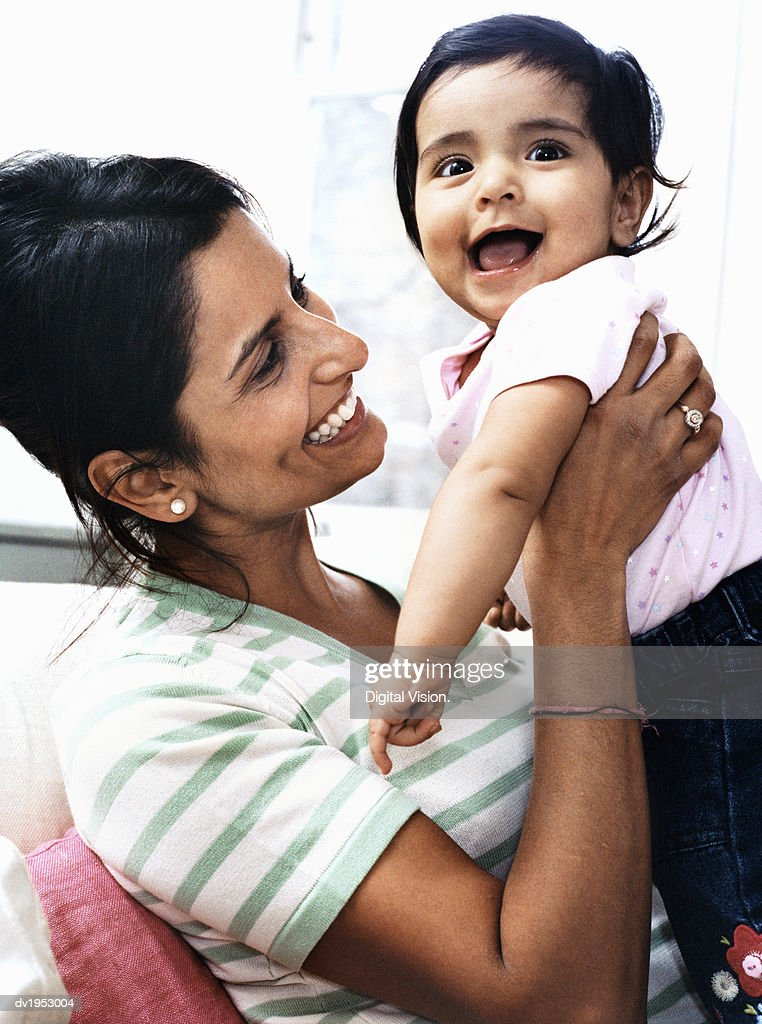 Mother Holding Her Baby Daughter : Stock Photo
