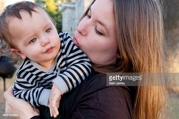mother holding her baby son - hazel bond stock photos and pictures