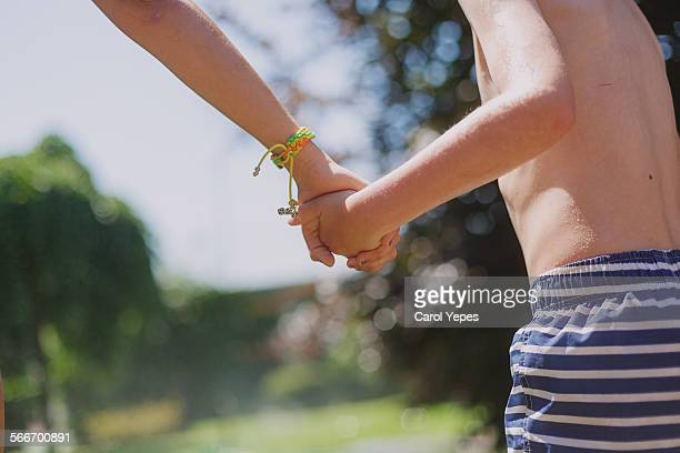 Mother holding his son´s hand