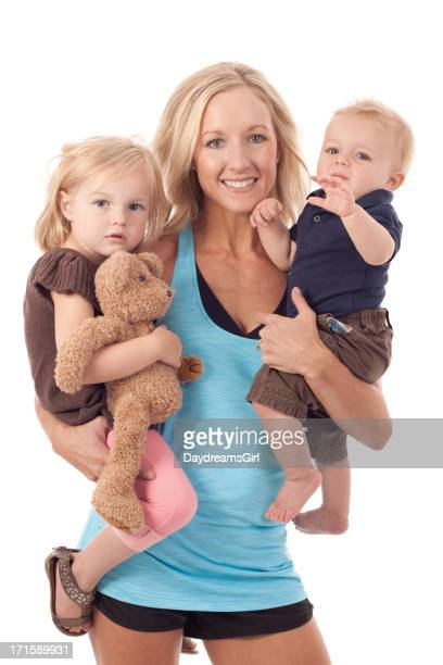 Mother Holding Little Girl and Baby Boy