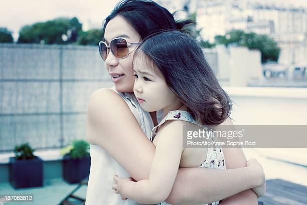 Mother holding little girl