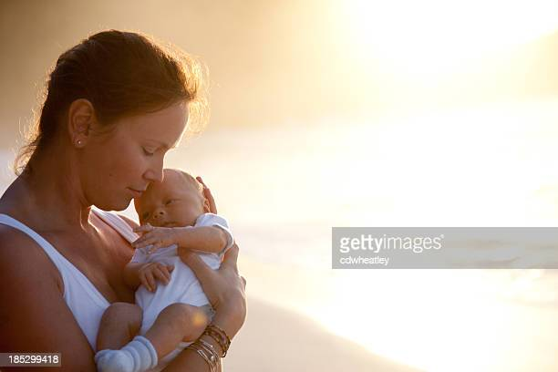 mother holding newborn child in her arms