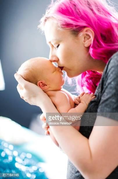 Mother holding newborn son (2-5 months)