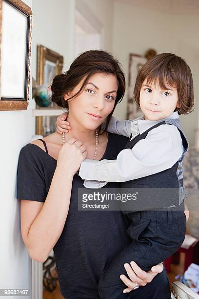 mother holding son in her arms
