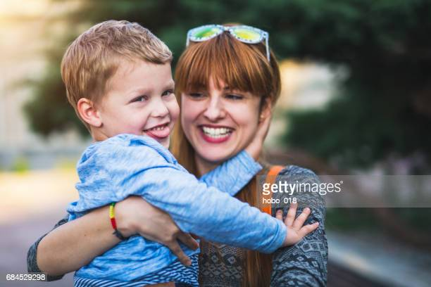 mother holding son - aunt stock pictures, royalty-free photos & images