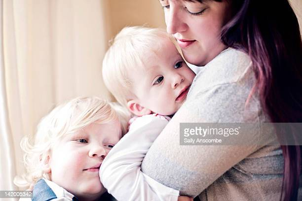 Mother holding two children