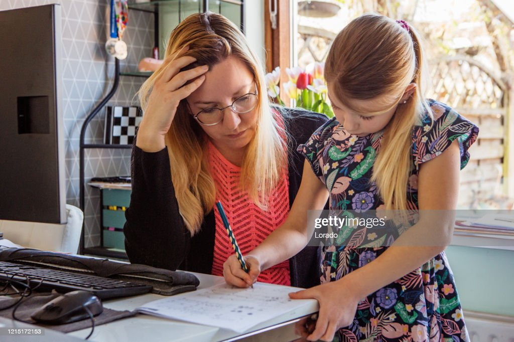 Mother Home Schooling her young daughter : Stock Photo