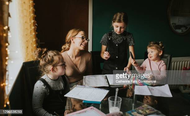 mother homeschooling her children - inconvenience stock pictures, royalty-free photos & images