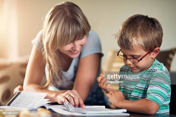 Mother homeschooling her son