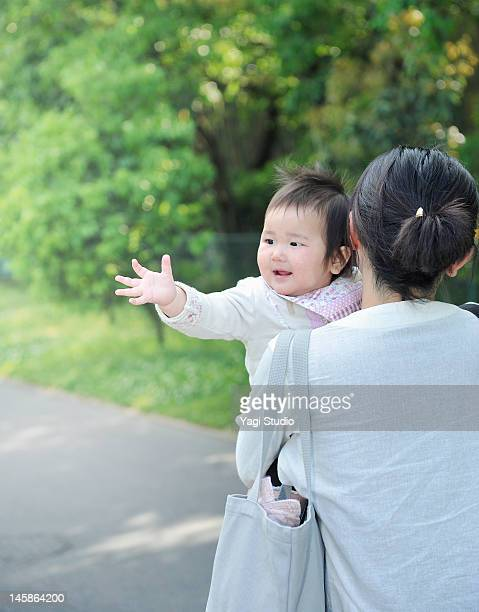 mother hugging baby girl - shoulder bag stock pictures, royalty-free photos & images