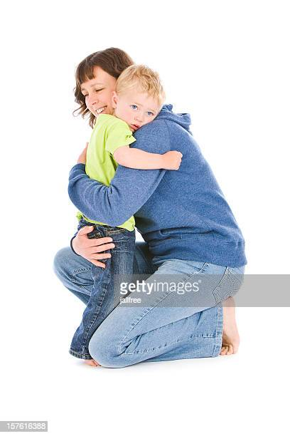 Mother hugging blond young boy on white background