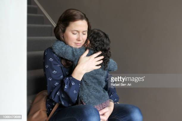 Mother Hugging Daughter at Home