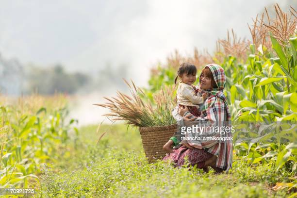 mother hugging her cute daughter with love - ラオス ストックフォトと画像