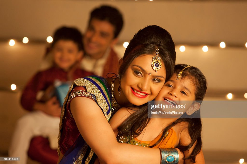 Mother hugging her daughter : Stock Photo